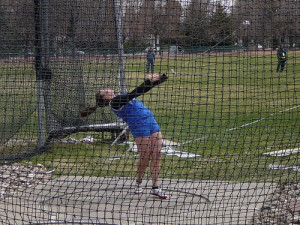 female athlete competing in hammer throw